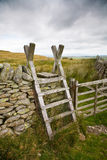 Traditional Ladder Stile. Old wooden ladder stile set against the beautiful Cumbrian countryside Royalty Free Stock Image