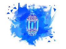 Traditional Lamp for Ramadan Kareem celebration. Beautiful floral Lamp on Mosque decorated abstract blue paint stroke background for Islamic Holy Month of