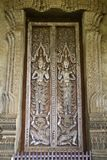 Traditional Lao style Buddhist church door Royalty Free Stock Photos