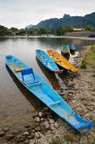 Traditional Laos longtail boat at Vang Vieng, Laos Royalty Free Stock Photos