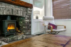 Traditional large brick fireplace in a living room Royalty Free Stock Photo