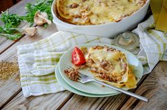 Traditional lasagna made with minced beef bolognese sauce and bechamel sauce with pepper and herbs stock photo