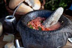 Traditional Latin American mexican Tomato sauce salsa, chilean chancho en piedra in stone mortar. royalty free stock photo