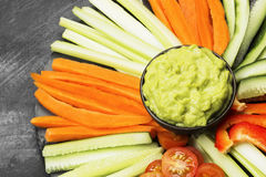 Traditional Latin American sauce guacamole in a bowl and various Stock Images