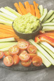 Traditional Latin American sauce guacamole in a bowl and various Stock Image