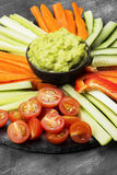 Traditional Latin American sauce guacamole in a bowl and various Royalty Free Stock Photography