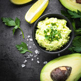 Traditional latinamerican mexican sauce guacamole on black. Stock Photography