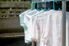 Traditional laundry in South East Asia. Hanging clothes under th Stock Images