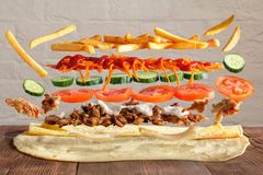 Traditional lavash dish with levitating ingredients from meat and vegetables. stock images