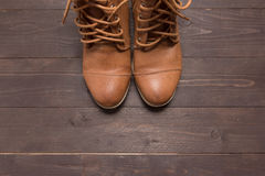 Traditional leather cowboy boots are on the wooden background Stock Photo
