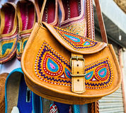 Traditional leather ethnic bag at a market Stock Images