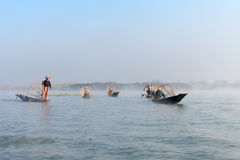 Traditional leg rowing fishermen in early morning Stock Images