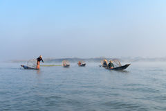 Traditional leg rowing fishermen in early morning Royalty Free Stock Image