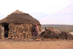 Traditional lesotho house and people Royalty Free Stock Image
