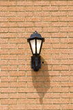 Traditional Light on Brick Wall Royalty Free Stock Photos
