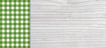 Traditional light grey plank with green tablecloth. Traditional light grey wooden plank with copy space and tablecloth checkered white and green Stock Photos