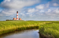 Traditional lighthouse with beautiful landscape at North Sea Stock Photos