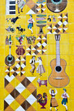Traditional Lisbon ceramic tiles. With Portugal symbols: rooster, dancers, bull, fish, guitar stock photography