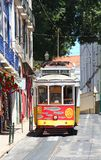 Traditional Lisbon yellow tram decorated with sardines Stock Image