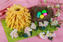 Traditional Lithuanian cake on skewer Easter Bread Decorated Eggs Stock Photo