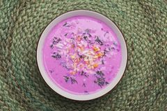 Traditional lithuanian cold beet pink soup. Prepared of cucumber, beetrot, eggs and sour cream,  called saltibarsciai Stock Photos