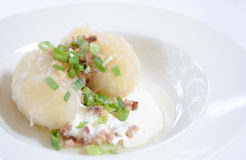 Traditional Lithuanian dish meal cuisine - stuffed meat potato dumpling (Cepelinai,didzkukuliai),Lithuanian national dish, curd royalty free stock images