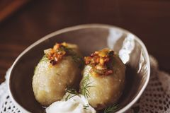 Traditional Lithuanian dish of stuffed potato dumplings cepelinai. The dumplings are made from grated and riced potatoes and stock photo