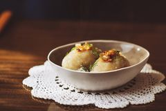 Traditional Lithuanian dish of stuffed potato dumplings cepelinai. The dumplings are made from grated and riced potatoes and stock photos