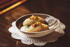Traditional Lithuanian dish of stuffed potato dumplings cepelinai. The dumplings are made from grated and riced potatoes and stock image