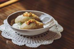 Traditional Lithuanian dish of stuffed potato dumplings - cepelinai stock image