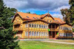 Traditional Lithuanian wooden and half-timber houses in the countryside. Juodkrante village, Lithuania. Royalty Free Stock Photo