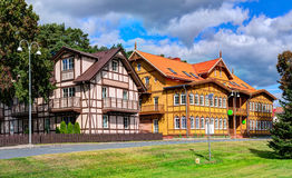 Traditional Lithuanian wooden and half-timber houses in the countryside. Juodkrante village, Lithuania. Royalty Free Stock Image