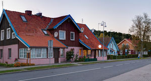 Traditional Lithuanian wooden house in the countryside. Juodkrante village, Lithuania. Stock Images
