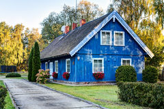 Traditional Lithuanian wooden house in the countryside. Pervalka village, Lithuania. Stock Images