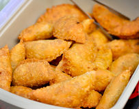 Traditional local food curry puff. Close up of traditional local food curry puff, selective focus royalty free stock photo