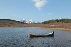 Traditional Lofoten's boats and mountains Stock Photos