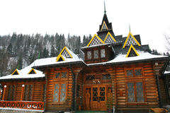 Traditional log house. Traditional ethnic log house and firtrees Stock Photography