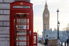 Traditional London red phone box and Big ben in early morning Royalty Free Stock Image