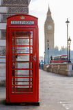 Traditional London red phone box and Big ben in early morning Royalty Free Stock Photography