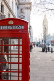Traditional London red phone box and Big ben in early morning Stock Photo