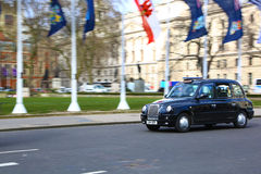 Traditional London taxi in Parliament square Stock Images