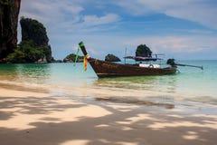 Traditional long tail boat, beautiful beach and limestone landscape Royalty Free Stock Photo