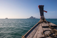 Traditional long tail boat is sailing on Andaman sea in Thailand. Traditional long tail boat is sailing on Andaman sea with a blue sky in thailand Royalty Free Stock Images