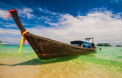 Traditional long tail boat Thailand in turquoise waters of Andaman Sea Royalty Free Stock Photos