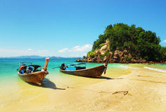 Traditional long tail boats on the beach, Thailand Stock Photography