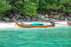 Traditional longtail boat in bay on Phi Phi Island, Krabi,Thailand beach Royalty Free Stock Photo