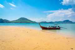 Traditional longtail boat near tropical island Stock Photos