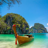 Traditional longtail boat near tropical island Royalty Free Stock Image
