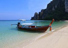 Traditional longtail boat on Thailand island beach Royalty Free Stock Photos