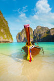 Traditional Longtail Boat Tied to a Tropical Beach in Thailand Stock Image